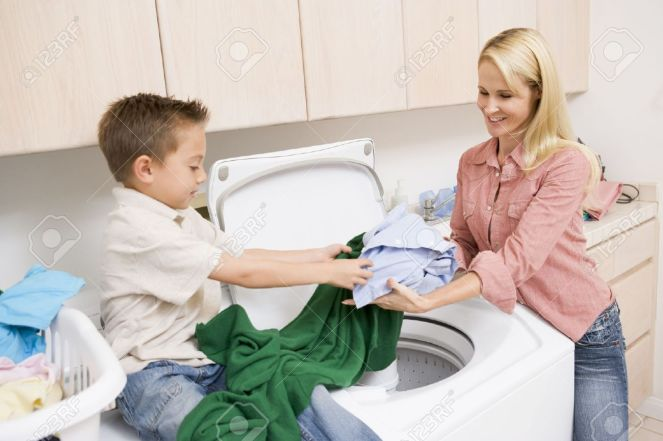 4444955-Mother-And-Son-Doing-Laundry--Stock-Photo-laundry-machine-washing