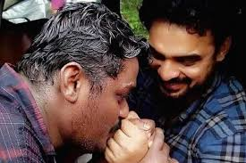 A Man Kisses Actor Tovino's Hands for All the Help he did in his Hometown